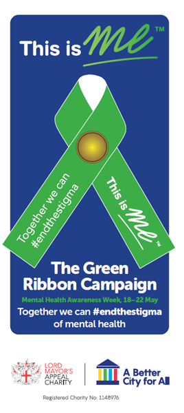 Image of table talker, which has a green ribbon on the front and information about the campaign on the back.